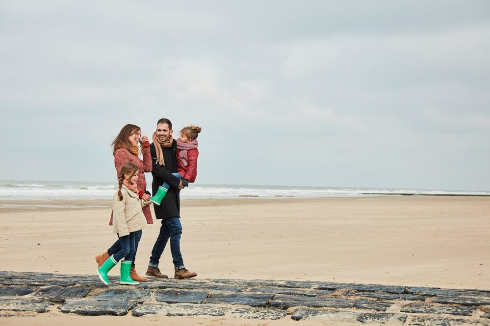 Family on the beach at the Belgian Coast