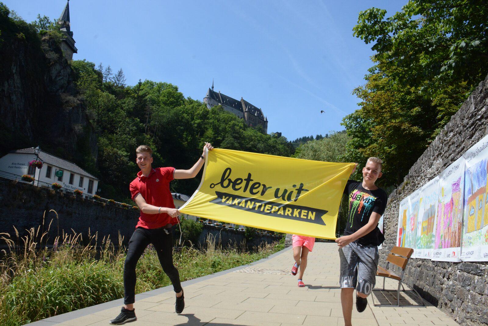 Boys running with flag Vianden