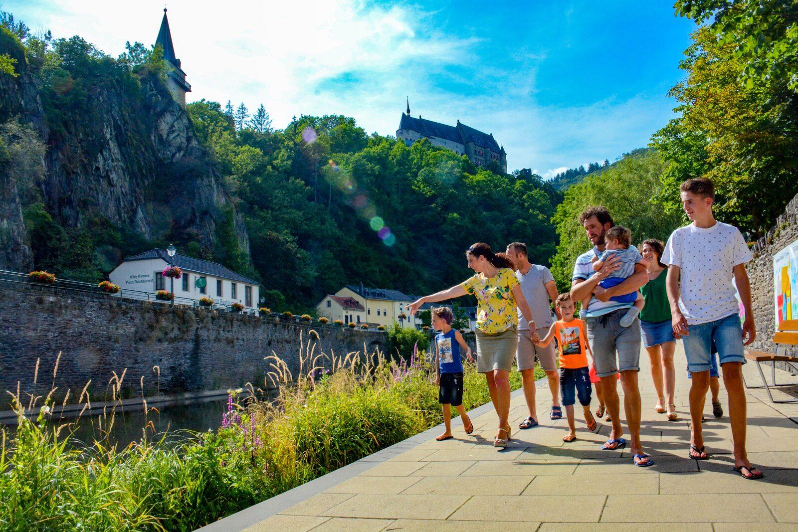 Family walking along water Vianden