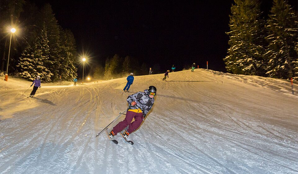 Enjoy night skiing and sledding at mountain Flumserberg